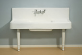 THE CLARION 5' CAST IRON FARMHOUSE DRAINBOARD SINK WITH P0813 SINK LEGS.