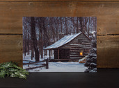 LIGHTED SNOW CAPPED CABIN CANVAS