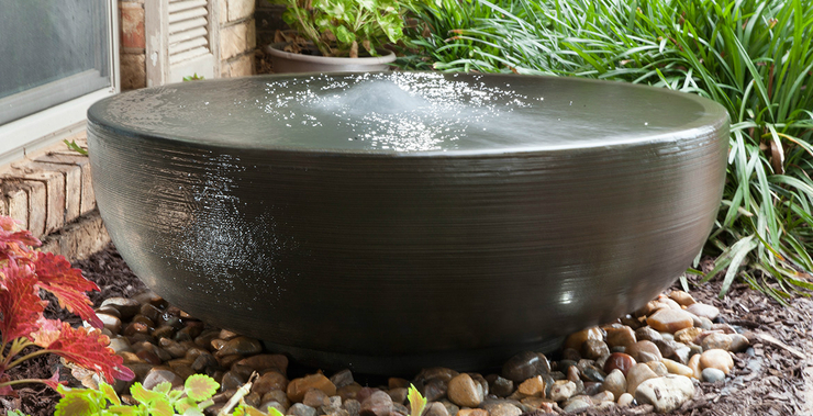 Decorative water fountains and features little giant for Decorative fish pond covers